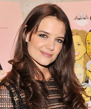 Katie Holmes opted for a soft and feminine beauty look with fluffy curls and shiny lip gloss.