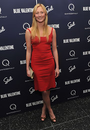 Maggie Rizer paired a fiery red cocktail dress with on-trend leopard peep toe pumps.