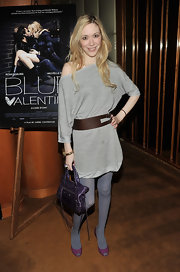 "Melissa attended the ""Blue Valentine"" premiere with her purple leather Balenciaga bag in tow."