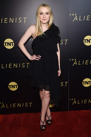 Dakota Fanning finished off her dress with a pair of black lace peep-toes by Christian Louboutin.