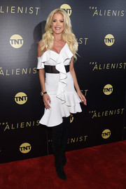 Victoria Silvstedt toughened up flirty dress with black thigh-high boots.