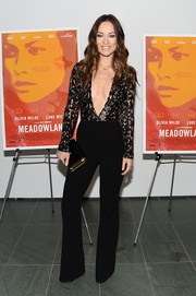 Olivia Wilde looked perfectly svelte in a deep-V black jumpsuit by Michael Kors at the New York screening of 'Meadowland.'