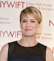 Robin Wright styled her hair into a short emo cut for the 2013 Muse Awards.