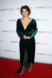 Zazie Beetz looked sexy-glam in an emerald velvet wrap gown with a plunging neckline at the Designing Women Awards.