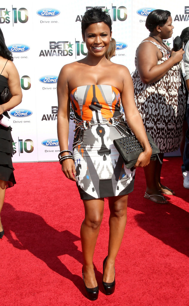Nia Stood Out In A Printed Spring 2010 Mini Dress With Metal Hardware Belted