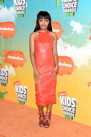 Keke Palmer completed her edgy-glam ensemble with strappy red heels by JF London.