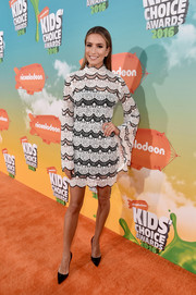 Renee Bargh went demure in a black-and-white bell-sleeve lace dress by Asilio for the Nickelodeon Kids' Choice Awards.