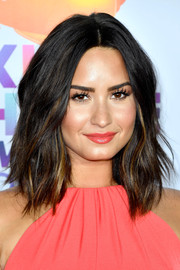 Demi Lovato made her eyes pop with those ultra-long false lashes.