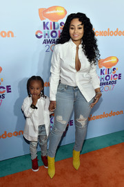 Blac Chyna showed some cleavage in a half-unbuttoned shirt at the 2017 Kids' Choice Awards.