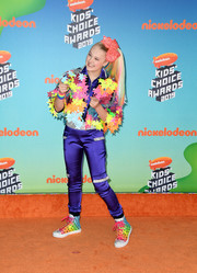 JoJo Siwa donned a purple satin jumpsuit with silver trim for the 2019 Kids' Choice Awards.