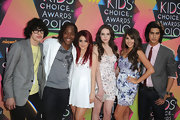 Daniella Monet posed with co-stars wearing waist-hugging print dress at the Kids' Choice Awards.
