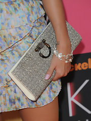 Nikki Reed paired her printed dress with a shimmering crystal link bracelet.
