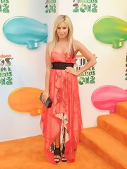 Ashley Tisdale showed off her California vibe in this strapless coral handkerchief dress. The playful choice of footwear and streaks of purple in her hair were perfectly appropriate for the event.