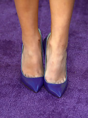 Olivia Holt chose bright purple pumps to add some color to her look at the Kids' Choice Awards.