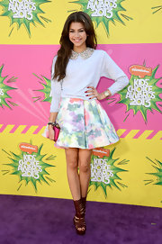 Zendaya Coleman dressed up a casual sweatshirt by pairing it with this bedazzled collar dress.