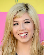 Jennette McCurdy picked a metallic pink lip to brighten her pearly whites.