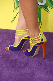 Stefanie Scott chose these neon, strappy sandals with a cool peep toe for her quirky look on the purple carpet.