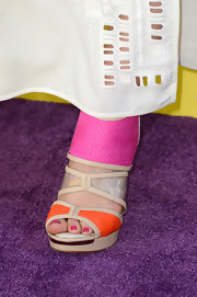 Gracie Dzienny chose these colorful orange and pink sandals to add some color to her all-white look at the KCAs.