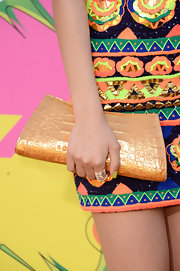 A metallic orange clutch gave Victoria Justice's evening look a fun and flirty touch.