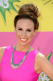 A bright coral lip color brought out the fuchsia and orange of Keltie Colleen's dress.