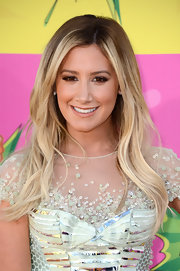 Ashley Tisdale stuck to a more neutral beauty look with this nude lip.
