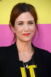 Kristen Wiig jazzed up a basic red lip with this color, which had a slight orange undertone.
