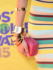 Zendaya Coleman went all out with the colors, pairing a pink Ethan K box clutch with her striped outfit.