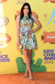 Ariel Winter made her dress stand out by choosing simple accessories, including a pair of nude Stuart Weitzman ankle-strap sandals.