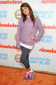 Daniella Monet kept herself comfy by wearing a knit sweater and a pair of leggings at Nickelodeon's Worldwide Day of Play.