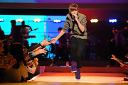 Bieber fever continues.  Here, Justin Bieber dances onstage in a pair of black pants.