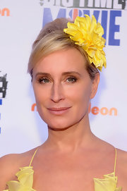 Sonja Morgan attended the premiere of 'Big Time Movie' wearing her hair in a chic French twist with side-swept bangs and a large yellow flower accent.