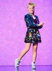 For her footwear, JoJo Siwa chose a pair of custom basketball sneakers.