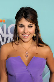 Daniella Monet arrived at the 2011 TeenNick HALO Awards wearing standout jewelry, including a triple crystal pendant necklace.