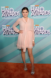 Ariel Winter paired her pale pink frock with glittering evening T-strap sandals.