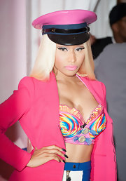 Nicki Minaj matched her pink blazer with a pink captain's hat for her fragrance launch.