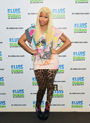 Nicki Minaj was funky in this tee and leopard leggings ensemble for her visit to the Z100 Studio.