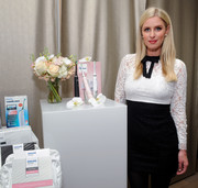Nicky Hilton looked ultra girly in a bow-adorned black-and-white lace mini while promoting Philips Sonicare.