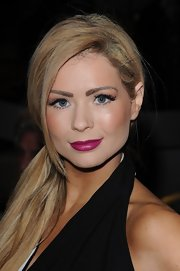 Nicola McLean tied her tresses in a low ponytail at London Fashion Week.
