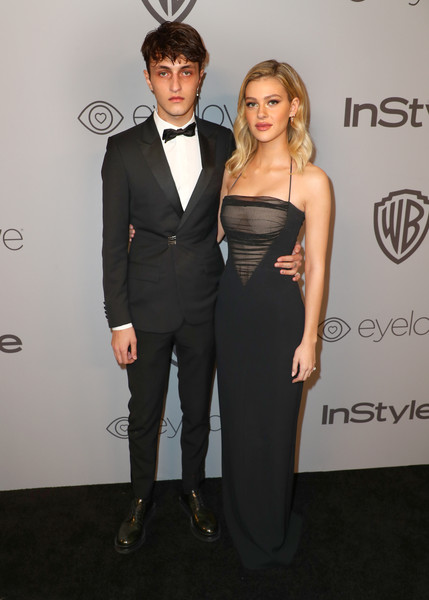 Nicola Peltz Halter Dress [clothing,suit,dress,formal wear,fashion,carpet,hairstyle,tuxedo,shoulder,event,nicola peltz,anwar hadid,the beverly hilton hotel,beverly hills,california,instyle,l,red carpet,warner bros. 75th annual golden globe awards,warner bros. 75th annual golden globe awards post-party]