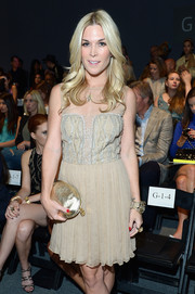 Tinsley Mortimer attended the Nicole Miller fashion show sporting an elegant cocktail dress and metallic gold clutch combo.