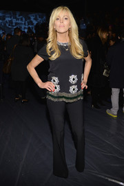 Dina Lohan brought some sparkle to the Nicole Miller fashion show with this bejeweled black blouse.