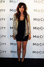 Nicole spiced up her little black dress with a gold sequin jacket.