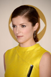 Anna Kendrick went for sleek styling with this side-parted chignon when she attended the 'Night That Changed America' show.