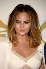 Chrissy Teigen styled her hair with a center part and wavy ends for the 'Night That Changed America' show.