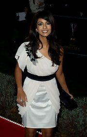 Konnie looks elegant in a black and white one-shoulder dress with an appliqued shoulder.