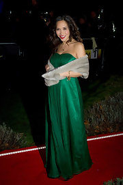 Myleene dons a strapless green floor sweeping dress with a subtle sweetheart neckline.
