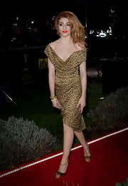 Nicola put her best foot forward in a pair of gold bow-adorned heels. Christian Louboutin's Archidisco T-bar sandals paired perfectly with the crimson haired singer's Vivienne Westwood dress.