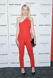 Dakota Fanning chose a black leather clutch to team with her jumpsuit.