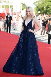 Dakota simply stunned in a flowing cobalt blue full gown at the Venice Film Festival.
