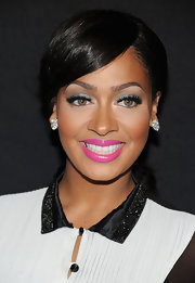La La Anthony finished off her beauty look with a sweet pink lip color.